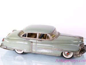 Marusan Shoten Tin-Cars Friction Powered Cadillac Series 62 Sedan